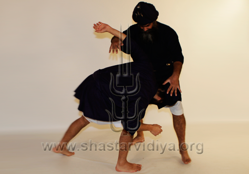 Nihang Nidar Singh executing a technique in the Narsingha Yudhan combat style