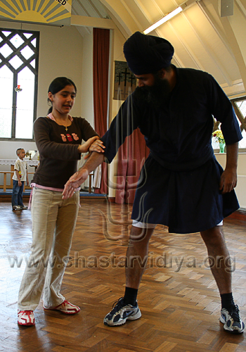 Young female Shagird (student) demonstrating a traditional Sava Rakhsha technique, Slough